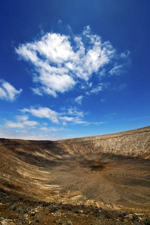 timanfaya: vulcanic timanfaya  rock stone sky  hill and summer in los volcanes lanzarote spain plant flower bush Stock Photo