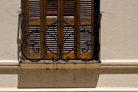 grate: old window grate and shadow in the centre of colonia del sacramento uruguay