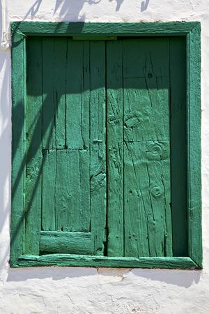 lanzarote: spain green wood   window in a white wall arrecife lanzarote Stock Photo