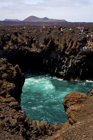 los hervideros: people   coastline stone volcanic spain  water  in lanzarote los hervideros sky cloud beach  and summer Stock Photo
