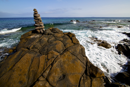 froth: in lanzarote coastline  froth  spain pond  rock stone sky cloud beach  water  musk  and summer