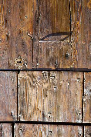 curch: varese  sumirago  abstract   rusty brass brown knocker in a  door curch  closed wood lombardy italy