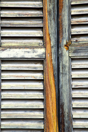 venetian blind: window  varese palaces italy abstract      wood venetian blind in the concrete  brick