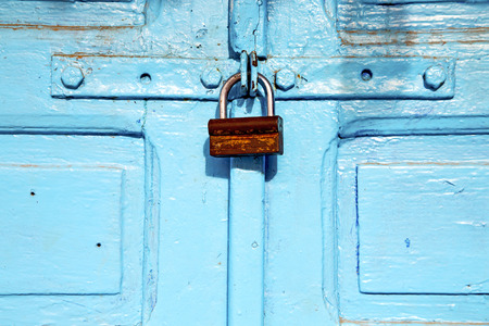 old wooden door: morocco in africa the old wood  facade home and rusty safe padlock Stock Photo