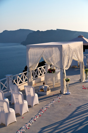 christian marriage: anniversary  and marriage cerimony in the sea of santorini greece island europe