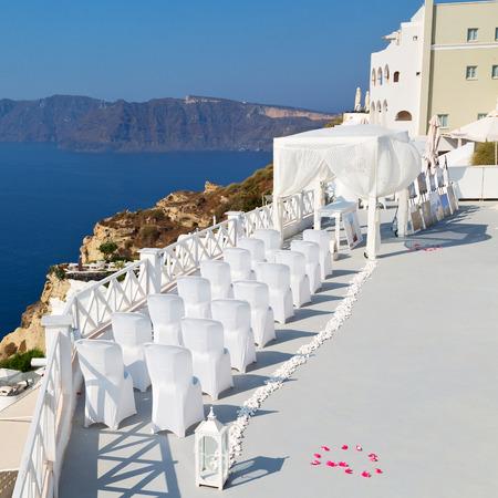 christian marriage: anniversary and marriage cerimony in the sea of santorini greece island europe Stock Photo