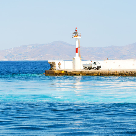 lighthouse  in the mediterranean sea cruise greece island in santorini europe boat harbor and pier
