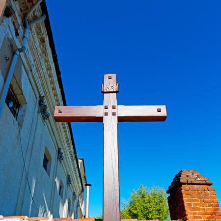 inri: wall abstract     cross in     italy europe and the sky background Stock Photo