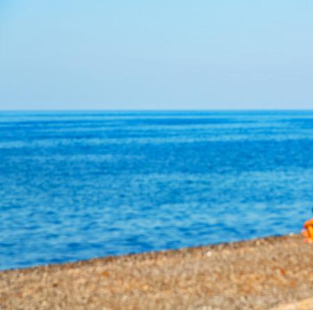 longue: in      greece  the  mykonos  island rock sea and beach    sky