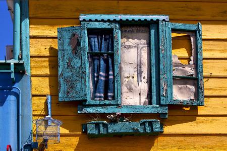 la boca: green venetian blind and a yellow wall  in la boca buenos aires argentina