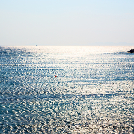 froth: foam and froth in the sea    of mediterranean greece