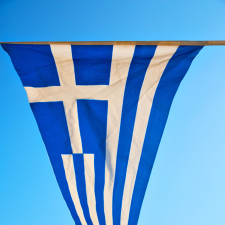 flan: waving greece flan in the blue sky and      flagpole