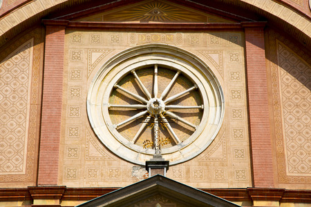 rose window: italy  lombardy     in  the  lonate ceppino  old   church   closed brick tower   wall rose   window tile Stock Photo