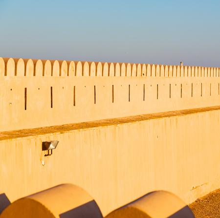 defensive: fort battlesment sky and    star brick in oman   muscat the old defensive Stock Photo