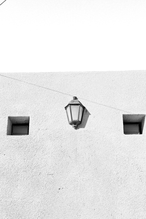 oman background: and abstract background in oman old streetlamp in the wall Stock Photo