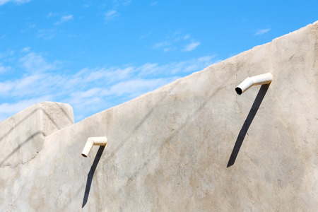 roofing system: water pipe for  the rain in antique oman house Stock Photo