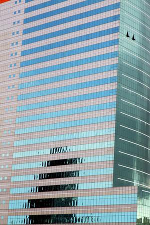 reflex: asia bangkok  thailand reflex of some blue palace skyscraper in a window    the centre