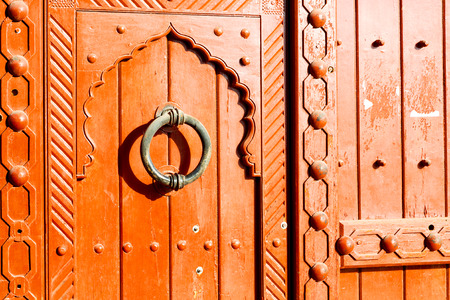 oman background: in oman antique door entrance and      decorative handle for background Stock Photo