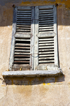 venetian blind: lonate ceppino varese italy abstract  window      wood venetian blind in the concrete  blue