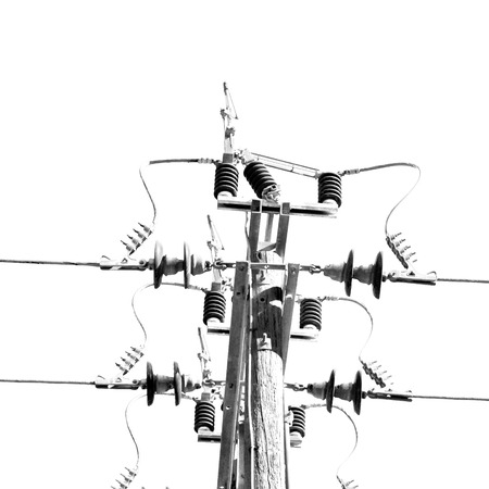 electric current: wood pylon energy and current line   in oman the electric cable
