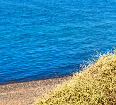 in      greece  the  mykonos island rock sea and beach    sky
