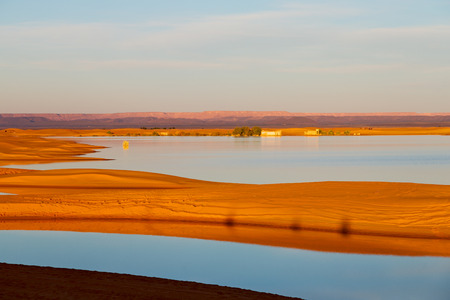 sunshine in the desert of morocco sand and  lake        dune Stock Photo