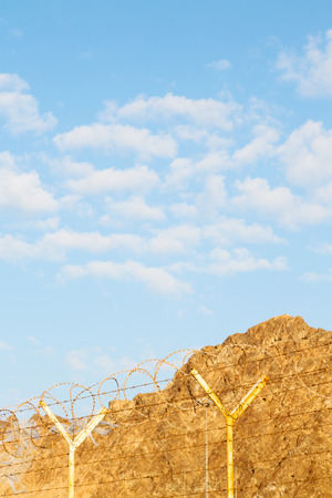 and cloudy sky in oman barbwire in the background Stock Photo