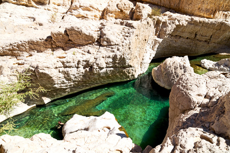 oman old mountain and water in canyon wadi oasi nature paradise Stock Photo
