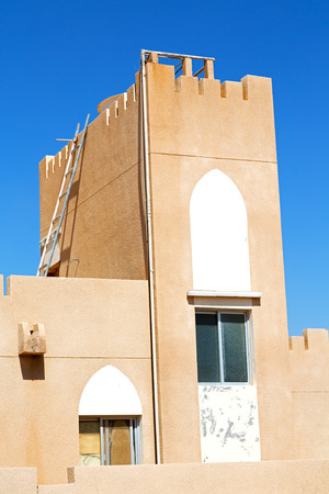 at close quarters: in oman new house brick building    the city backgroun sky
