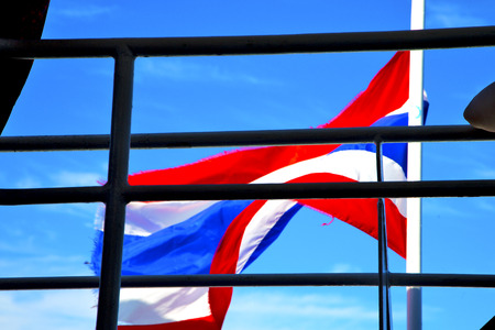 asia  kho samui bay isle waving flag    in thailand and  grate blue sky