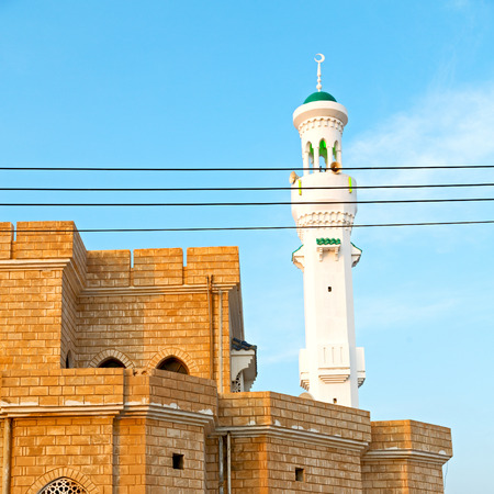 oman background: minaret and religion in clear sky in oman muscat the old mosque Stock Photo