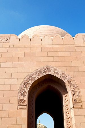 oman background: minaret and religion in clear sky in oman muscat the  old mosque