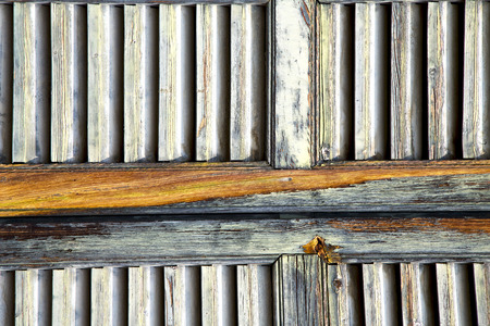 dirty sheet: window  varese palaces italy abstract      wood venetian blind in the concrete  brick