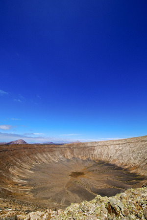 panoramas: stone in los volcanes lanzarote  spain volcanic timanfaya  rock  sky  hill and summer