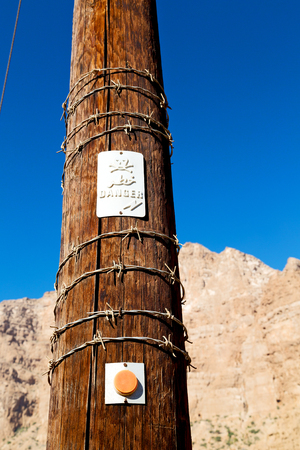 boundary: and  in oman barbwire danger  in the   background Stock Photo