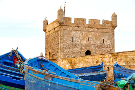 boat and sea in africa morocco old castle brown brick  sky Editorial