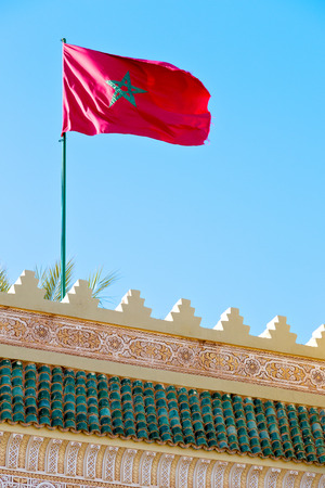 waving flag in the blue sky tunisia  colour and wave battlements