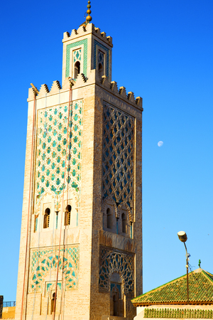 minaret: in maroc africa      minaret  and the blue     sky Editorial