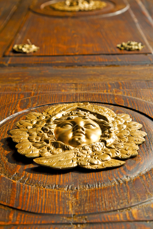 gold face  abstract  house door    in italy   lombardy   column  the milano old         closed nail rusty
