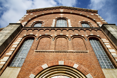 rose window: italy  lombardy     in  the   legnano  old   church   closed brick tower   wall rose   window tile Editorial