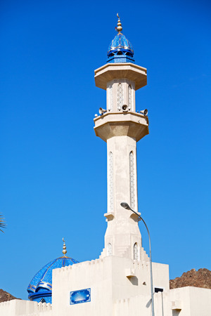 oman: minaret and religion in clear sky in oman muscat the old mosque Stock Photo