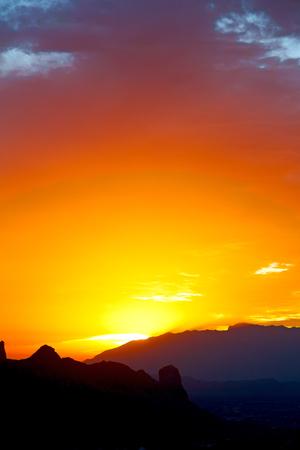 mid morning: the blurred  sun falling down arabian mountain  in   oman Stock Photo