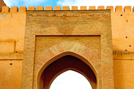 fes: olddoor in morocco  africa ancien and wall ornate brown blue Editorial