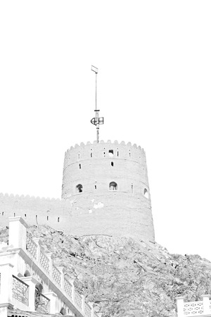 defensive: fort battlesment sky and   star brick in oman muscat the old defensive Editorial