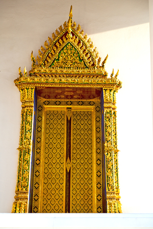 window   in   bangkok in thailand incision of the buddha gold      temple