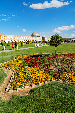 blur in iran   the old square of isfahan prople garden tree heritage tourism and mosque Editorial