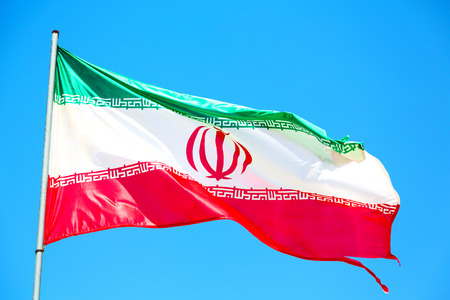 in iran iranian waving flag  the blue sky and wind Stock Photo
