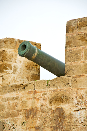 bombard: in africa morocco  green bronze cannon and the blue sky