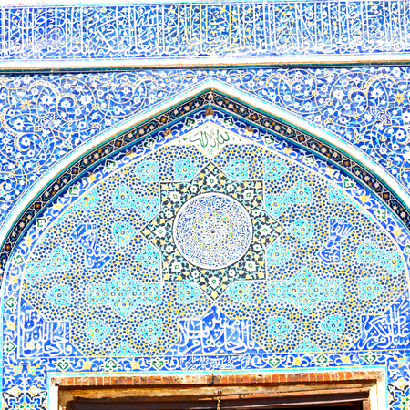 isfahan: blur in iran the old decorative flower  tiles from antique mosque like background