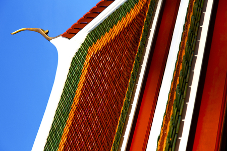 in the temple  bangkok thailand abstract cross colors roof wat  palaces   asia and sky Stock Photo